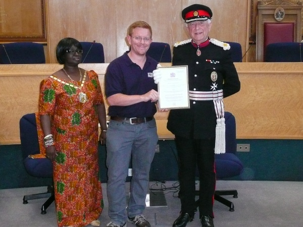 Our Coordinator John Goddard receiving the Queen's Award for Voluntary Service from Her Majesty the Queen's Deputy Lieutenant The Right Honourable Sir John Wheeler, DL in the presence of the then Mayor of Merton, Councillor Agatha Akyigyina.