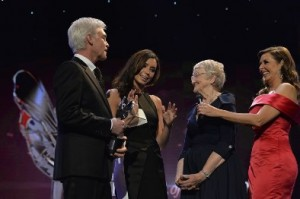 Anne Scarfe is presented with the ITV Local Hero by Christine Bleakley and Phillip Schofield at the Daily Mirror Pride of Britain Awards on Monday 7th October 2013, at Grosvenor House, London.