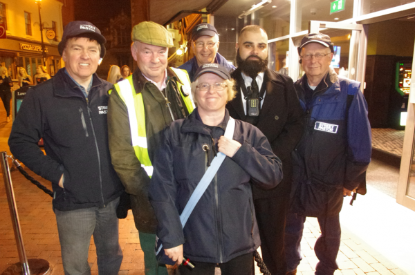 Warwickshire PCC, Philip Seccombe (in the Yellow Jacket), pictured with the Rugby Street Pastors and Doorstaff.