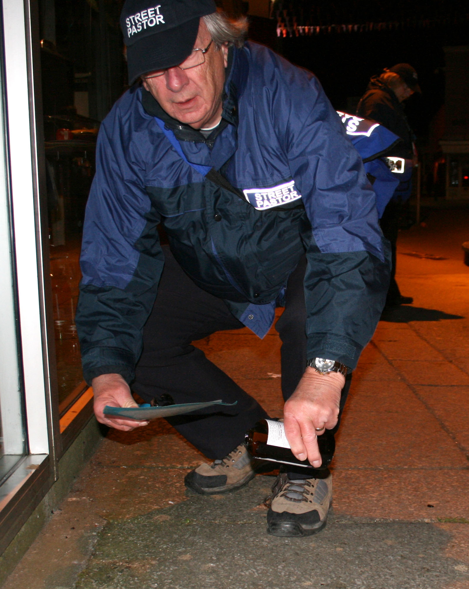 Sweeping up broken glass - Victoria Square - May 2015